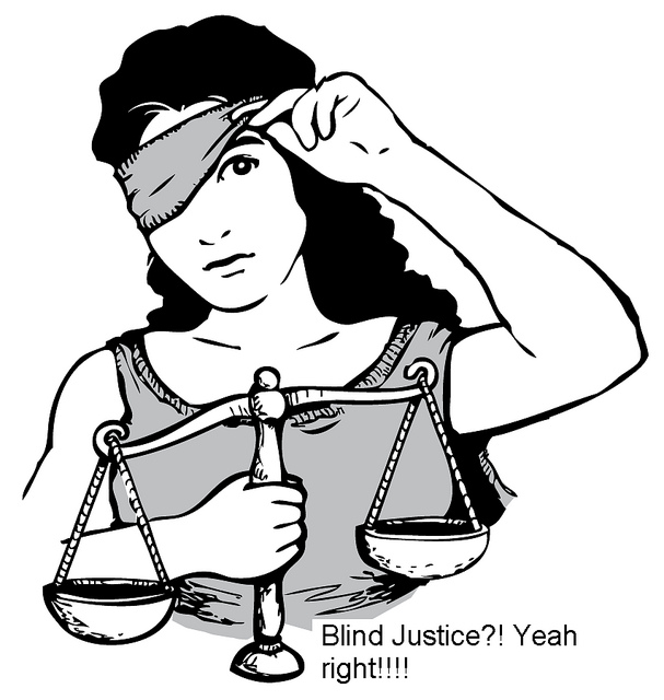 blind justice blindfold held up